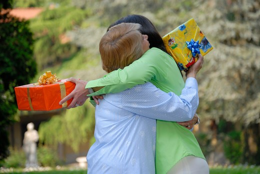 Mother and daughter in their birtday day embracing : Stock Photo