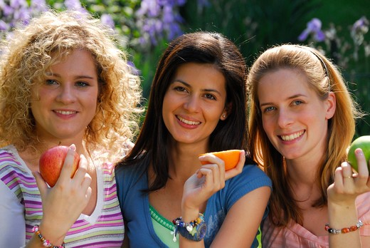 Stock Photo: 4292-109531 Portrait of a three friends with fruits