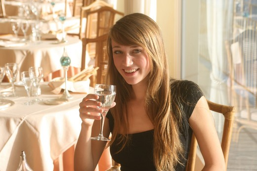 Portrait of a young woman in hotel restaurant : Stock Photo