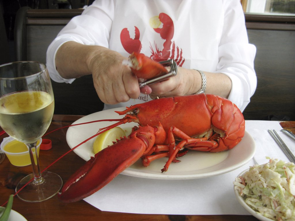 Woman eating lobster : Stock Photo