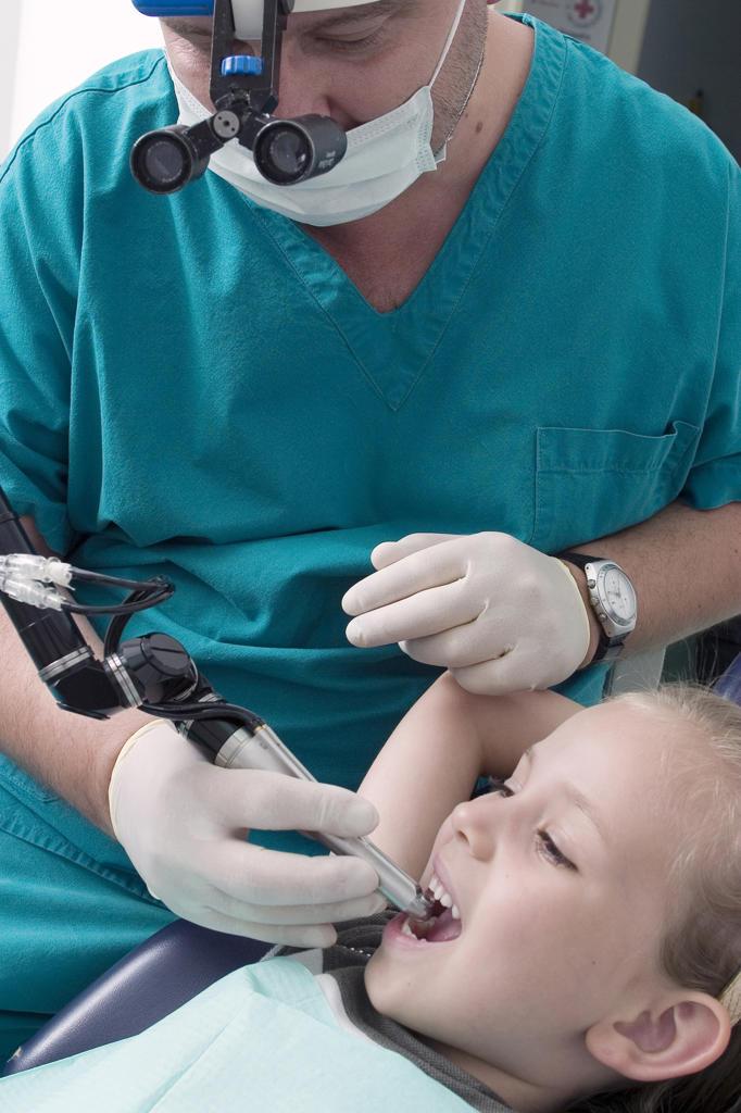 Girl having a dental examination : Stock Photo