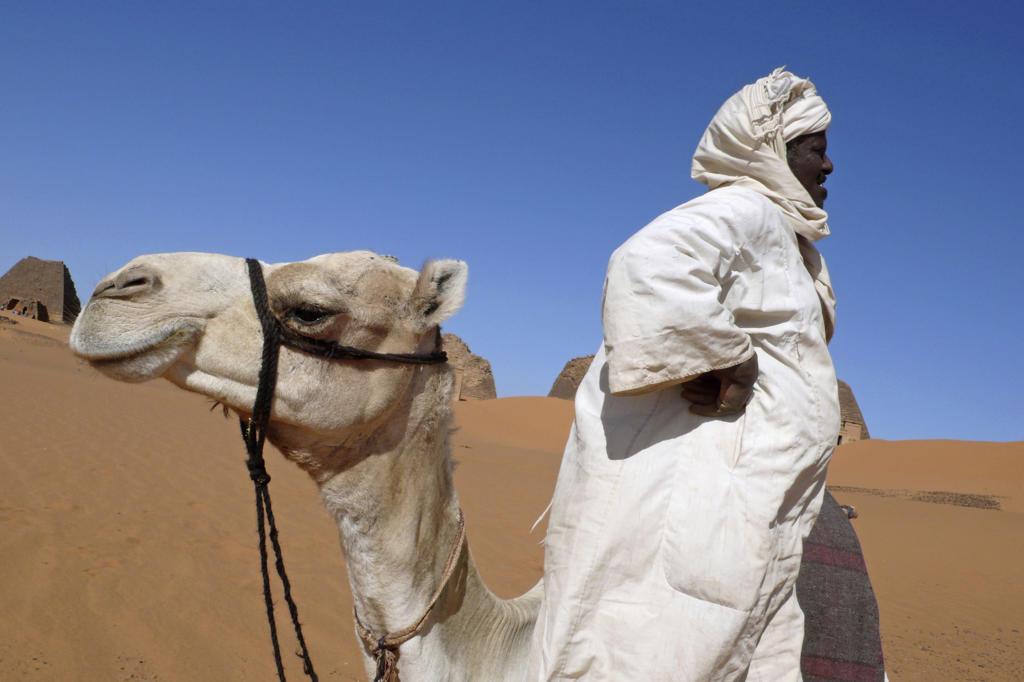 Africa, Sudan, Nubia, Meroe, local man at the ruins : Stock Photo