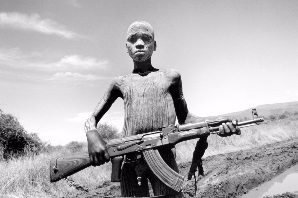 Stock Photo: 4292-122945 Africa, Ethiopia, South Omo, Mago National Park, Mursi man with body painting and AK47 rifle