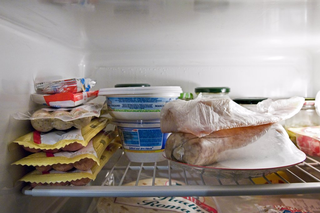 Assorted food in refrigerator : Stock Photo