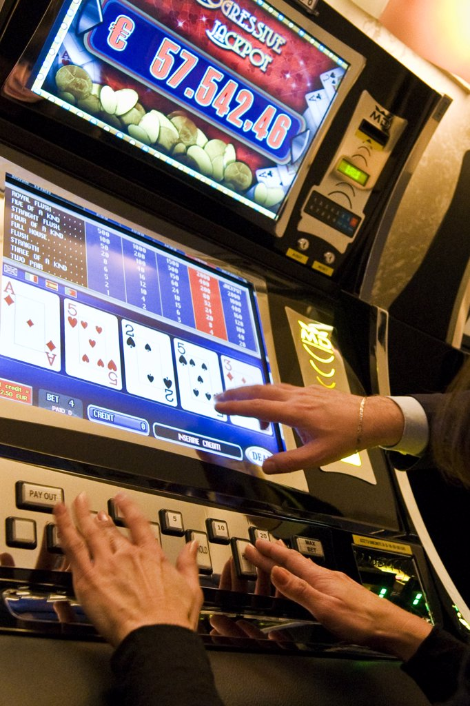 Stock Photo: 4292-123738 Italy, Val D'Aosta, Saint Vincent, people at slot machine