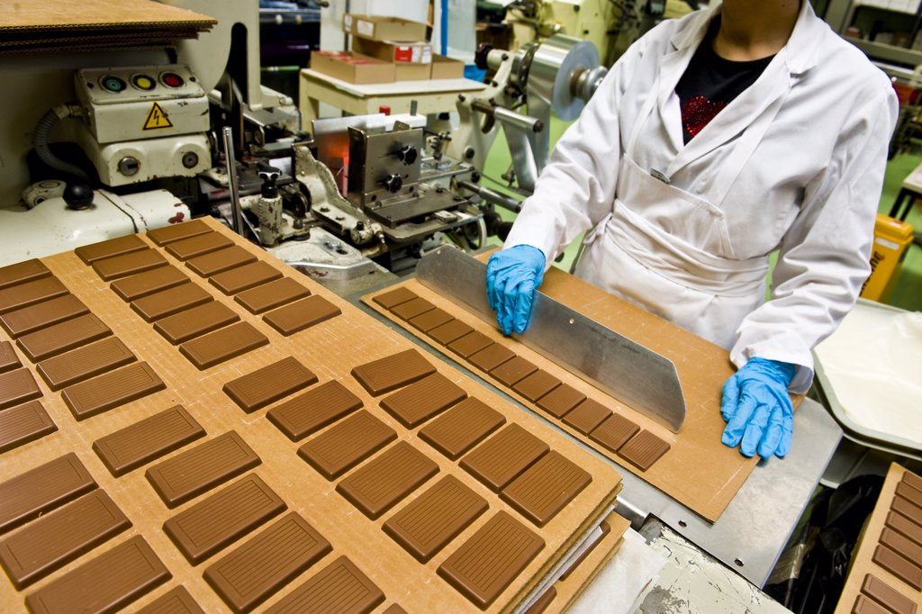 Switzerland, Giubiasco, Stella chocolate factory, making chocolate candy : Stock Photo