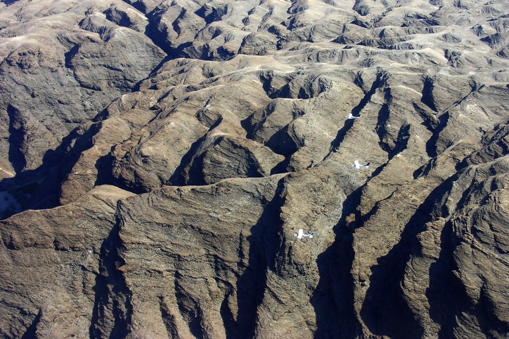 Stock Photo: 4292-124974 Africa, Namibia, aerial view of the desert and Cessna 210 airplane