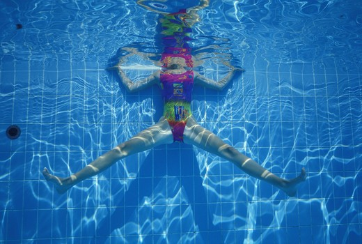 Detail of a woman in swimming pool exercising underwater view : Stock Photo