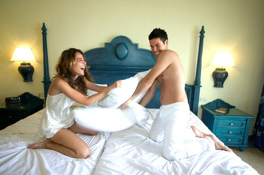 Couple having a pillow fight : Stock Photo