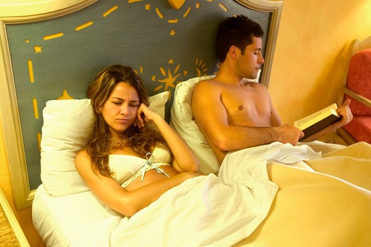 Stock Photo: 4292-12876 Couple in bed in disagreement
