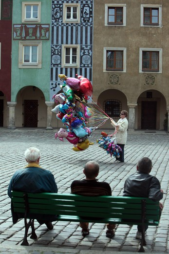 A balloon shop assistant in the Stary Rynek place in the starlings Miasto or Old Town in centre of Poznan or poses in great Pole in Poland. : Stock Photo