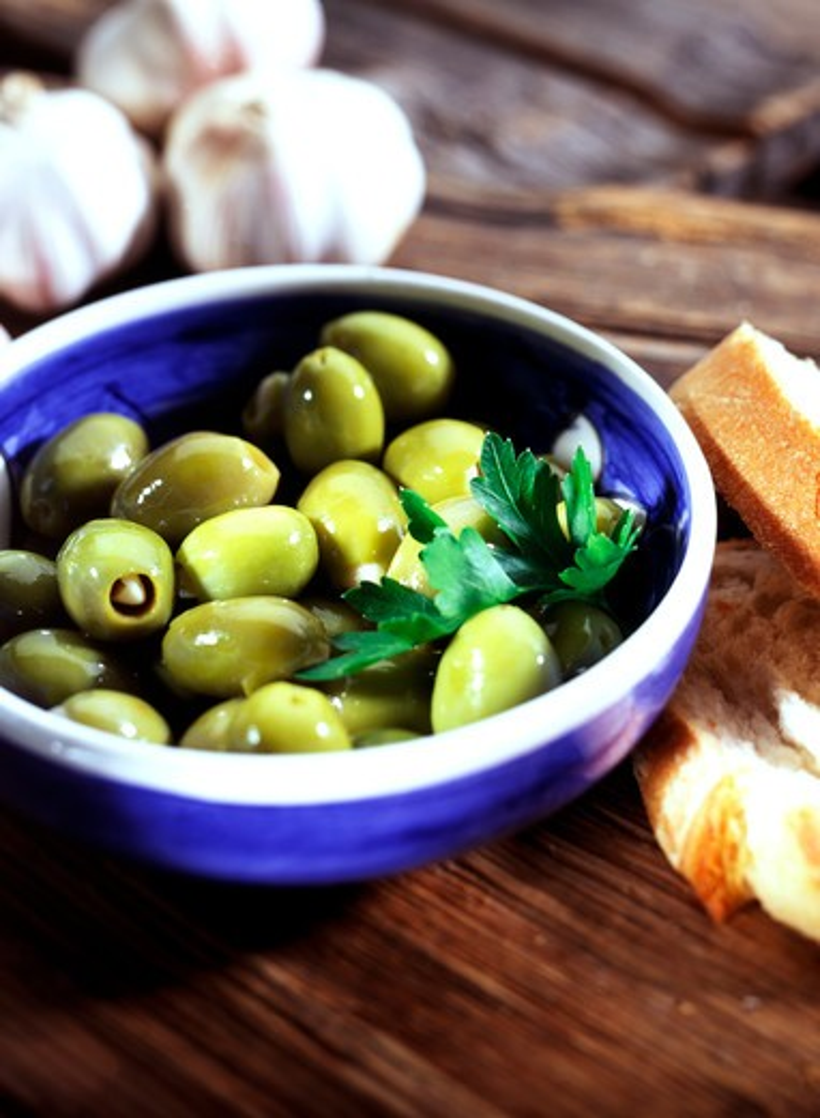 Stock Photo: 4292-130262 baguette, bread, diet, food, fruits, fresh, fruit, healthy, green, olive, olives, edible, stone fruit, still life, vitamin, vitamins, vitamin-rich, white bread, bowl, mediterranean