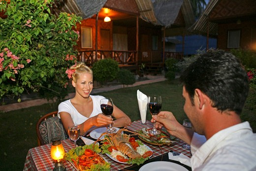 Stock Photo: 4292-131360 couple in love enjoying seafood at restaurant in yao yao island resort