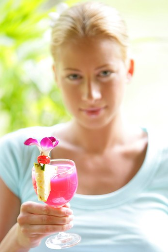 Stock Photo: 4292-131477 young blond woman enjoy some drink in summer holiday, portrait