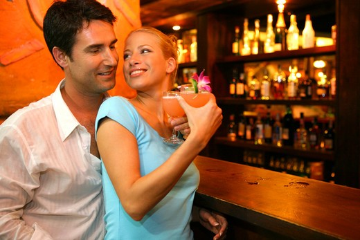 Stock Photo: 4292-131496 happy couple in love on bar in Railay Bay Resort