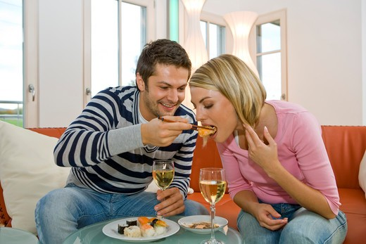 Stock Photo: 4292-131944 Couple esting Sushi