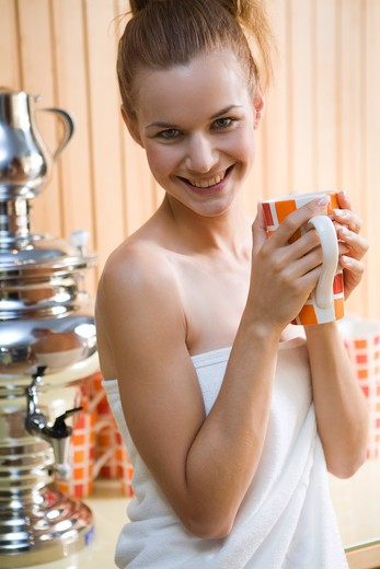 Stock Photo: 4292-132069 Young pretty woman drinking tea in welness centre.