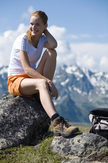 Young pretty woman having rest in the mountains. : Stock Photo