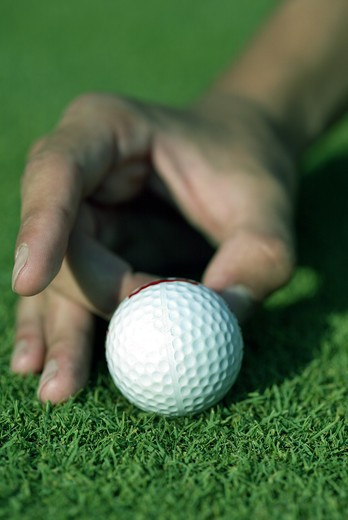 Hand play with golf ball : Stock Photo