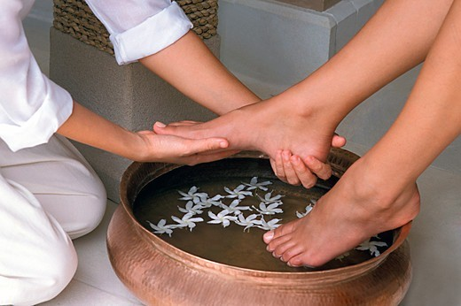 Stock Photo: 4292-137154 Woman getting a floral foot bath
