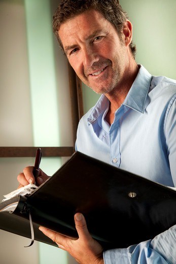 Stock Photo: 4292-138638 Businessman with stationary