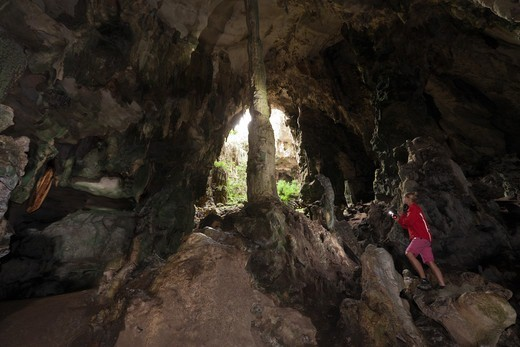 Stock Photo: 4292-140400 Tourist inside Kotilola Cave, Baliem Valley, West Papua, Indonesia