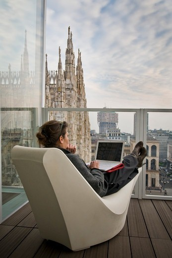 Stock Photo: 4292-141724 Woman with computer, The Cube, Milan, Italy