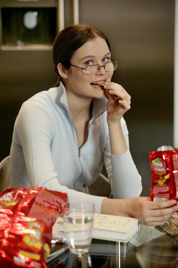 Stock Photo: 4292-14429 Woman eating potato chip