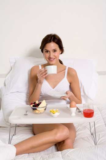 Stock Photo: 4292-14714 Woman having breakfast in her bed