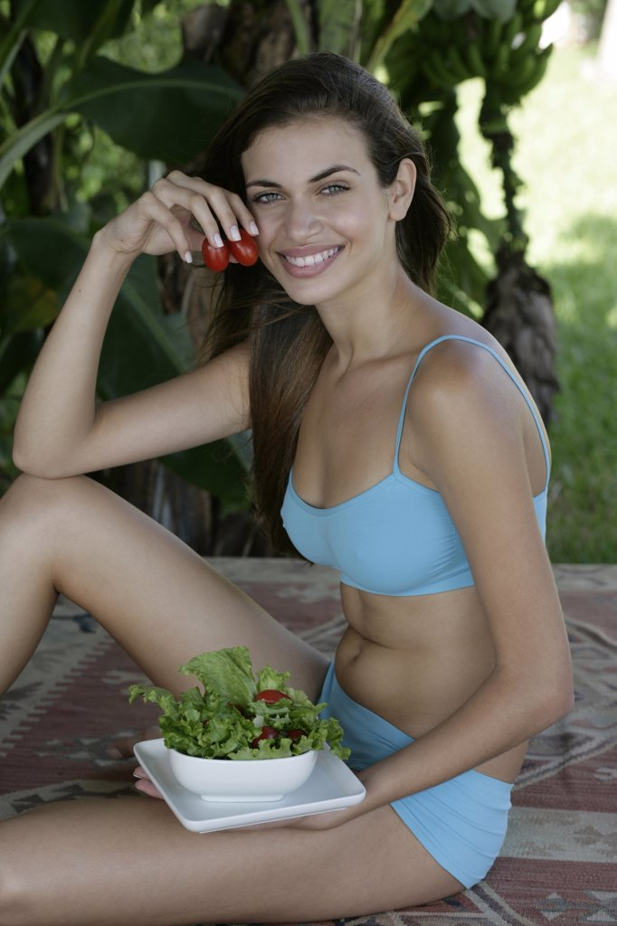 Stock Photo: 4292-14992 Young woman's portrait with salad