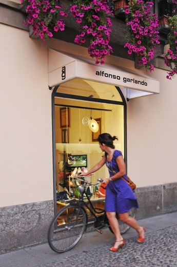 Stock Photo: 4292-151668 Italy, Lombardy, Milan, Brera district,woman shopping , shop window reflections