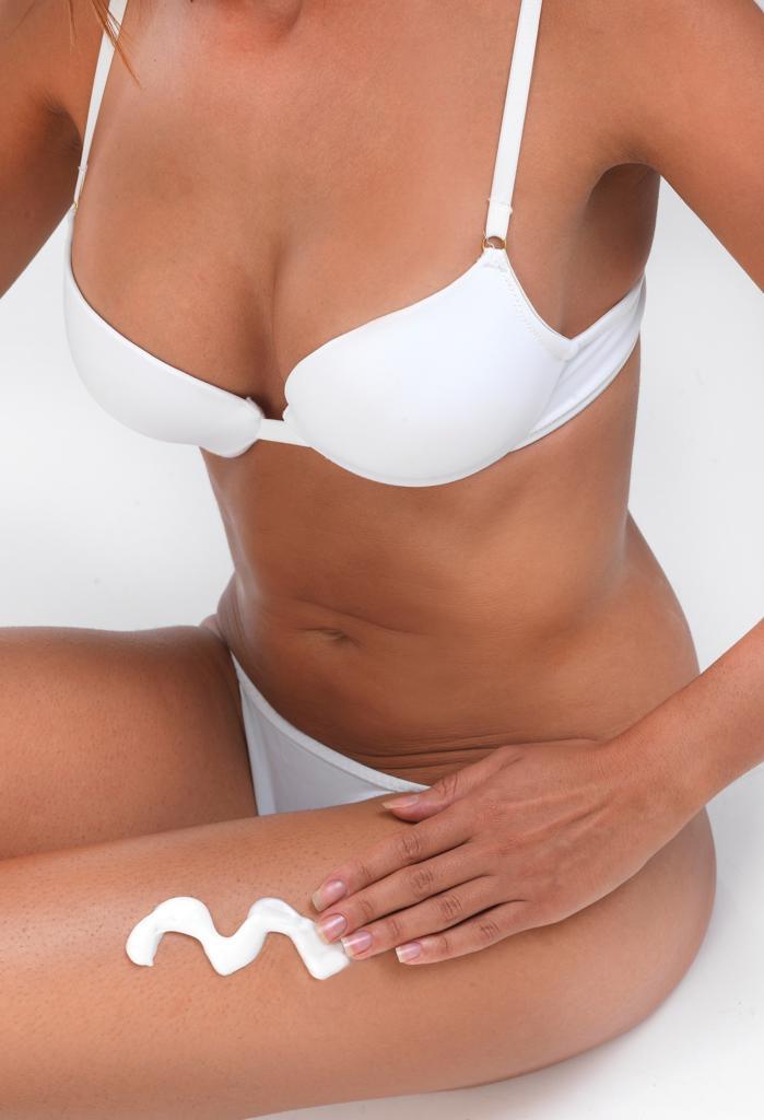 woman applying cream : Stock Photo