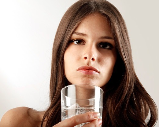 Stock Photo: 4292-151937 woman drinking a glass of water