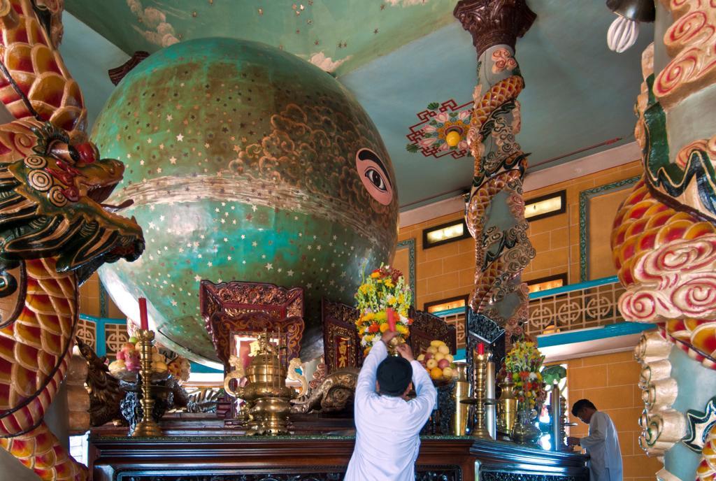 Vietnam, Cantho Prov, Mekong Delta, Priest decorating : Stock Photo