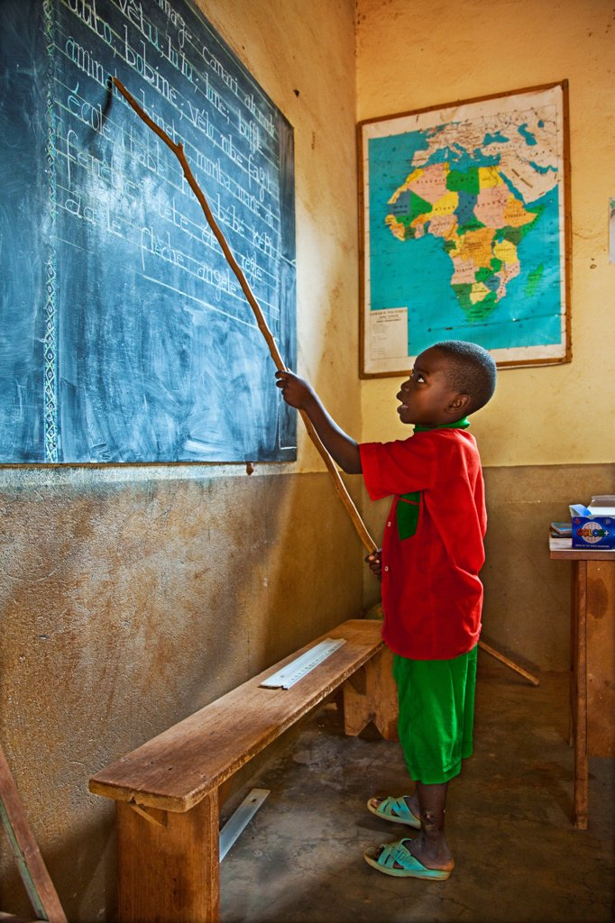 Africa, Republic Central Africa, Bozoum, a little student to the blackboard : Stock Photo