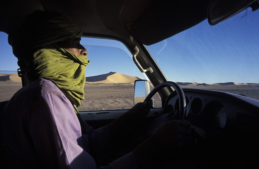 Stock Photo: 4292-16645 Algeria, Sahara, Erg Chech Desert, man in car