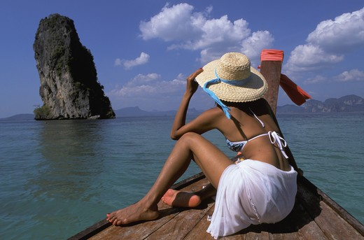 Stock Photo: 4292-32050 Thailand. Andaman Sea. Krabi. Woman on boat
