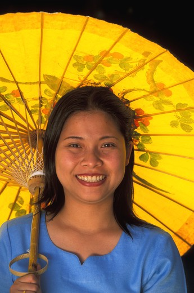Stock Photo: 4292-32364 Thailand, Chiang Mai. Sa Paper umbrella factory. Woman with paper umbrella