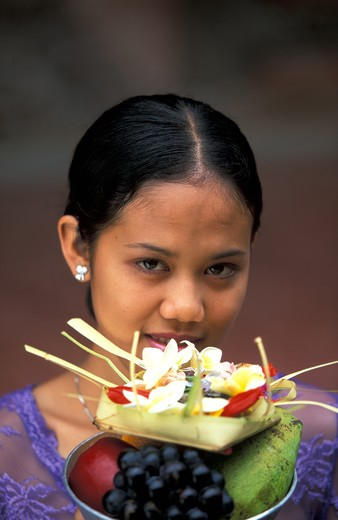 Stock Photo: 4292-32775 Indonesia, Bali, balinese woman making offering to Gods