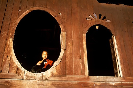 Stock Photo: 4292-33968 Myanmar, Shan State, Inle Lake, monk in wood monastery