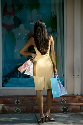 Stock Photo: 4292-34933 Woman looking at shop window