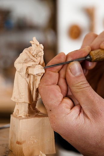 Stock Photo: 4292-3510 Italy, Trentino Alto Adige, Ortisei, artist Georg Demetz carving wood