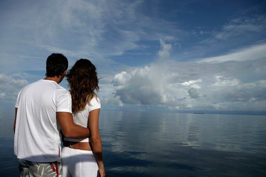 Stock Photo: 4292-35279 Couple at sea looking at horizon, Maldives
