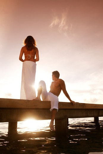 Stock Photo: 4292-35327 Couple on pier at sunset, Maldives