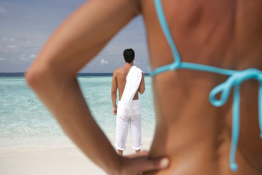 Rear view of couple at seaside : Stock Photo