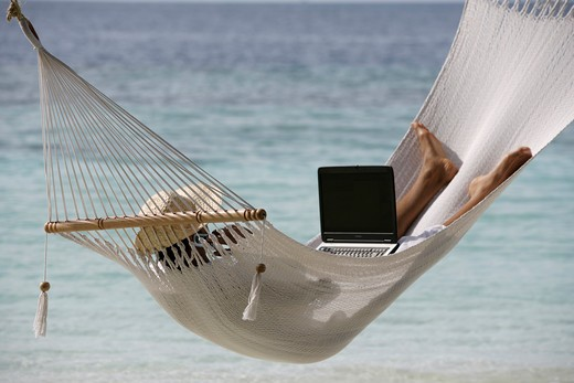 Stock Photo: 4292-35564 Man in hammock with laptop