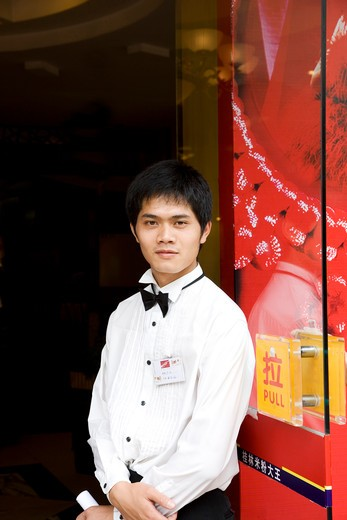 Stock Photo: 4292-36577 China, Guangxi Province, Guilin, Chinese waiter of local restaurant