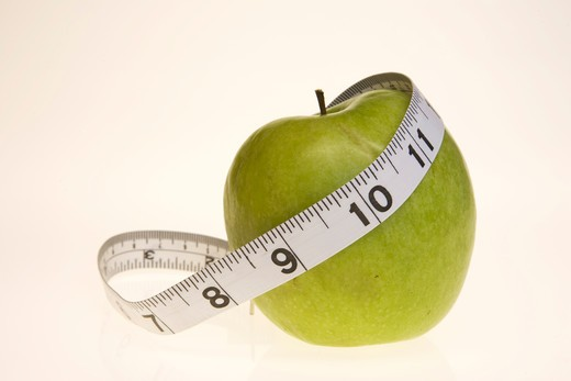 Apple with tape measure : Stock Photo
