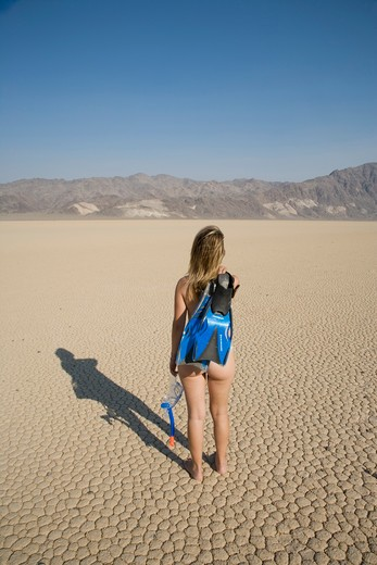 Stock Photo: 4292-37009 USA, California, Death Valley, walking woman