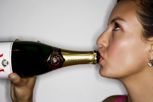 Stock Photo: 4292-37937 Young Latin Woman drinking champagne